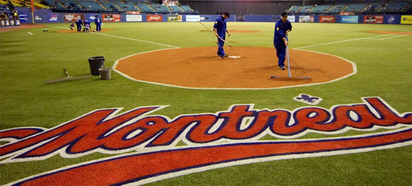 MONTREAL, QUE.: MARCH 28, 2014-- Grounds keepers from the Toronto Blue Jays prepare the field for preseason Major League Baseball game between the Blue Jays and the New York Mets at the Olympic Stadium in Montreal on Friday March 28, 2014.  (Allen McInnis / THE GAZETTE)  ORG XMIT: 49534